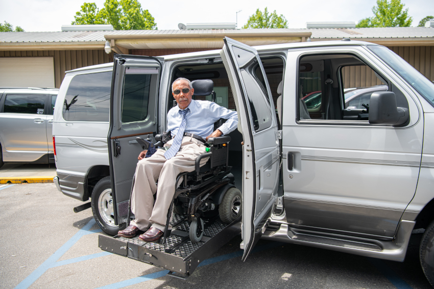 RV & Custom Lifts Example: An elderly gentleman uses a lift to exit with his powerchair from a large van